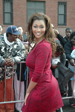 Toccara of America' Next Top Model fame swirls in her pretty red dress for the cameras on the red carpet.