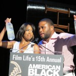 ABFF Honors Ceremony 49 - Regina and Anthony holding Grey Goose