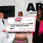 GMC Faith and Family Screenplay winner Nzinga Kadalie Kemp with award check