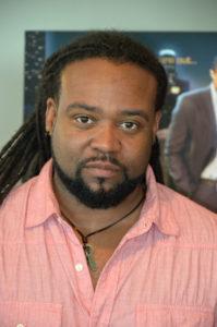Director Corey Grant